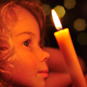 child looking at candle